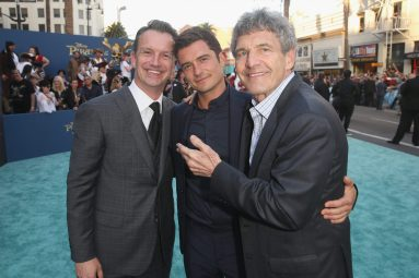 "HOLLYWOOD, CA - MAY 18: (L-R) President of Walt Disney Studios Motion Picture Production, Sean Bailey, Actor Orlando Bloom and Chairman, The Walt Disney Studios, Alan Horn at the Premiere of Disney's and Jerry Bruckheimer Films' ""Pirates of the Caribbean: Dead Men Tell No Tales,"" at the Dolby Theatre in Hollywood, CA with Johnny Depp as the one-and-only Captain Jack in a rollicking new tale of the high seas infused with the elements of fantasy, humor and action that have resulted in an international phenomenon for the past 13 years. May 18, 2017 in Hollywood, California. (Photo by Jesse Grant/Getty Images for Disney) *** Local Caption *** Sean Bailey; Orlando Bloom; Alan Horn"