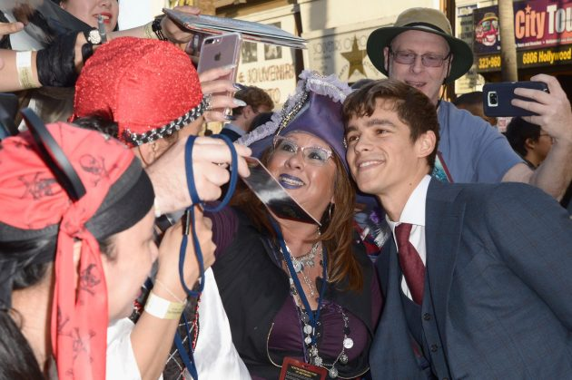 "HOLLYWOOD, CA - MAY 18: Actor Brenton Thwaites at the Premiere of Disney's and Jerry Bruckheimer Films' ""Pirates of the Caribbean: Dead Men Tell No Tales,"" at the Dolby Theatre in Hollywood, CA with Johnny Depp as the one-and-only Captain Jack in a rollicking new tale of the high seas infused with the elements of fantasy, humor and action that have resulted in an international phenomenon for the past 13 years. May 18, 2017 in Hollywood, California. (Photo by Marc Flores/Getty Images for Disney) *** Local Caption *** Brenton Thwaites"