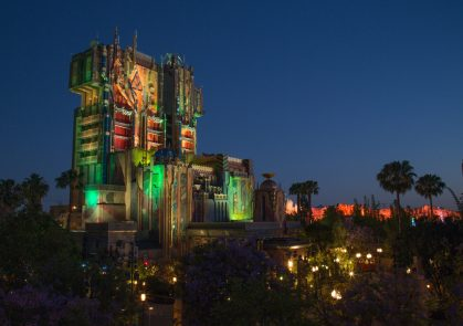 """Guardians of the Galaxy--Mission: BREAKOUT! — The exterior of The Collector's Fortress shimmers as night falls at Disney California Adventure Park. The all-new attraction Guardians of the Galaxy–Mission: BREAKOUT! will take guests through the Fortress of The Collector, who is keeping his newest acquisitions, the Guardians of the Galaxy, as prisoners. Guests will board a gantry lift which launches them into a daring adventure as they join Rocket in an attempt to set free his fellow Guardians. The epic new adventure blasts guests straight into the """"Guardians of the Galaxy"""" story for the first time, alongside characters from the blockbuster films and comics. As guests join Rocket in his attempt to bust his pals out of The Collector's Fortress, they will experience randomized ride experiences complete with new visual and audio effects and music inspired by the popular film soundtracks. (Rob Sparacio/Disneyland Resort)"""