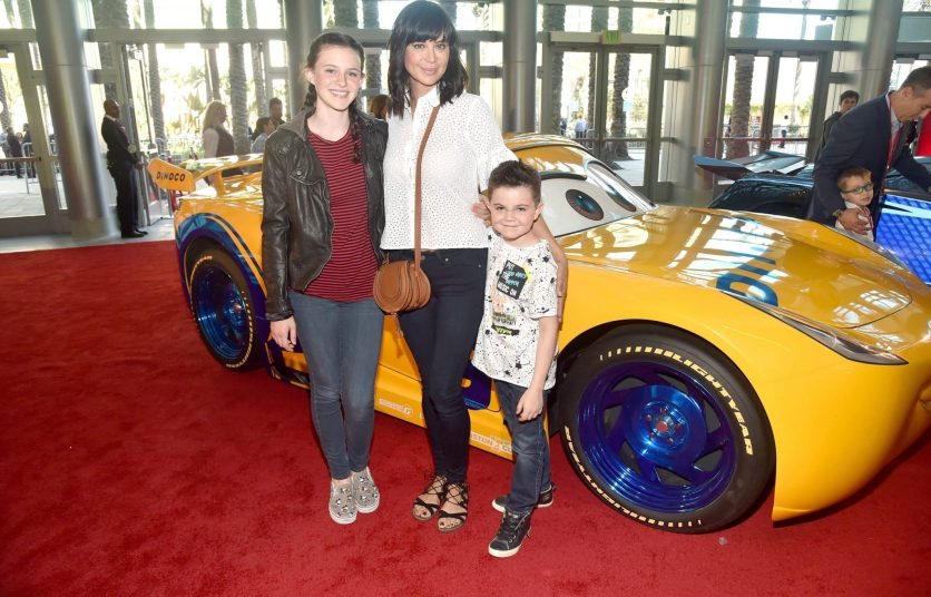 """ANAHEIM, CA - JUNE 10: (L-R) Gemma Beason, actor Catherine Bell, and Ronan Beason pose at the World Premiere of Disney/Pixarís ìCars 3"""" at the Anaheim Convention Center on June 10, 2017 in Anaheim, California. (Photo by Alberto E. Rodriguez/Getty Images for Disney) *** Local Caption *** Gemma Beason,Catherine Bell,Ronan Beason"""