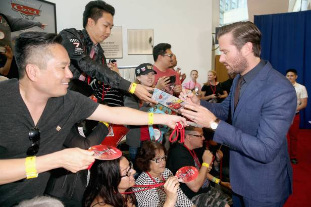 "ANAHEIM, CA - JUNE 10: Actor Armie Hammer (R) signs autographs at the World Premiere of Disney/Pixarís ìCars 3"" at the Anaheim Convention Center on June 10, 2017 in Anaheim, California. (Photo by Jesse Grant/Getty Images for Disney) *** Local Caption *** Armie Hammer"