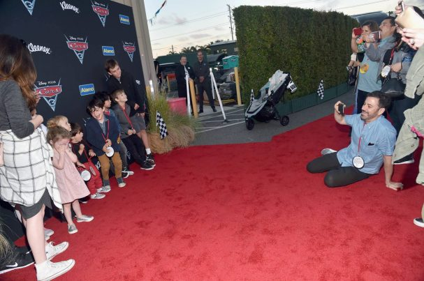 ANAHEIM, CA - JUNE 10: TV personality Jimmy Kimmel (R, seated) takes a picture of guests at the after party for the World Premiere of Disney/Pixarís ìCars 3î at Cars Land at Disney California Adventure in Anaheim, CA. (Photo by Alberto E. Rodriguez/Getty Images for Disney) *** Local Caption *** Jimmy Kimmel