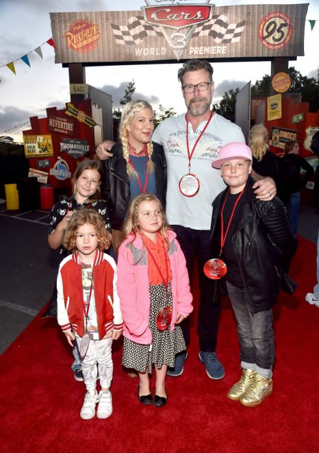 ANAHEIM, CA - JUNE 10: Actors Tori Spelling (back L) and Dean McDermott (back R) and guests pose at the after party for the World Premiere of Disney/Pixarís ìCars 3î at Cars Land at Disney California Adventure in Anaheim, CA. (Photo by Alberto E. Rodriguez/Getty Images for Disney) *** Local Caption *** Tori Spelling;Dean McDermott