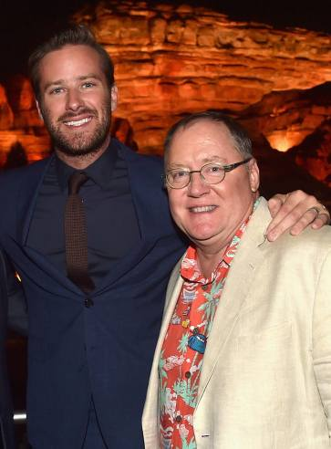ANAHEIM, CA - JUNE 10: Actor Armie Hammer (L) and executive producer John Lasseter pose at the after party for the World Premiere of Disney/Pixarís ìCars 3î at Cars Land at Disney California Adventure in Anaheim, CA. (Photo by Alberto E. Rodriguez/Getty Images for Disney) *** Local Caption *** Armie Hammer;John Lasseter