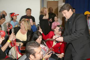 """ANAHEIM, CA - JUNE 10: Actor Nathan Fillion (R) signs autographs at the World Premiere of Disney/Pixarís ìCars 3"""" at the Anaheim Convention Center on June 10, 2017 in Anaheim, California. (Photo by Jesse Grant/Getty Images for Disney) *** Local Caption *** Nathan Fillion"""