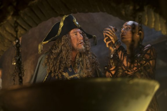 """""""PIRATES OF THE CARIBBEAN: DEAD MEN TELL NO TALES""""..The villainous Captain Salazar (Javier Bardem) pursues Jack Sparrow (Johnny Depp) as he searches for the trident used by Poseidon..Pictured L to R: Captain Hector Barbossa (Geoffrey Rush) and Shansa (Goldshifteh Farahani)..Ph: Peter Mountain..© Disney Enterprises, Inc. All Rights Reserved."""