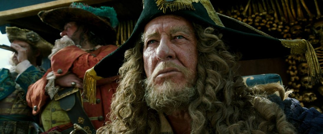 """PIRATES OF THE CARIBBEAN: DEAD MEN TELL NO TALES""..The villainous Captain Salazar (Javier Bardem) pursues Jack Sparrow (Johnny Depp) as he searches for the trident used by Poseidon..Pictured: Captain Hector Barbossa (Geoffrey Rush)..Ph: Film Frame..© Disney Enterprises, Inc. All Rights Reserved."