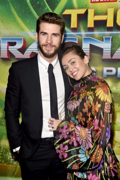 "HOLLYWOOD, CA - OCTOBER 10: Actor Liam Hemsworth (L) and Miley Cyrus at The World Premiere of Marvel Studios' ""Thor: Ragnarok"" at the El Capitan Theatre on October 10, 2017 in Hollywood, California. (Photo by Alberto E. Rodriguez/Getty Images for Disney) *** Local Caption *** Liam Hemsworth; Miley Cyrus"