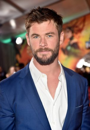 "HOLLYWOOD, CA - OCTOBER 10: Actor Chris Hemsworth at The World Premiere of Marvel Studios' ""Thor: Ragnarok"" at the El Capitan Theatre on October 10, 2017 in Hollywood, California. (Photo by Alberto E. Rodriguez/Getty Images for Disney) *** Local Caption *** Chris Hemsworth"
