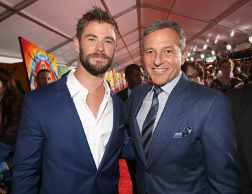 """HOLLYWOOD, CA - OCTOBER 10: Actor Chris Hemsworth (L) and The Walt Disney Company Chairman and CEO, Bob Iger at The World Premiere of Marvel Studios' """"Thor: Ragnarok"""" at the El Capitan Theatre on October 10, 2017 in Hollywood, California. (Photo by Jesse Grant/Getty Images for Disney) *** Local Caption *** Chris Hemsworth; Bob Iger"""