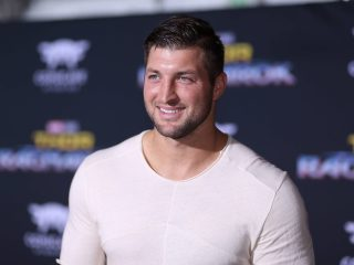 "HOLLYWOOD, CA - OCTOBER 10: Professional football player Tim Tebow at The World Premiere of Marvel Studios' ""Thor: Ragnarok"" at the El Capitan Theatre on October 10, 2017 in Hollywood, California. (Photo by Rich Polk/Getty Images for Disney) *** Local Caption *** Tim Tebow"