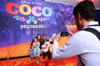 "HOLLYWOOD, CA - NOVEMBER 08: (L-R) Head of Daytime at CBS Angelica McDaniel and daughter, and guitarist Federico Ramos at the U.S. Premiere of Disney-Pixarís ""Coco"" at the El Capitan Theatre on November 8, 2017, in Hollywood, California. (Photo by Jesse Grant/Getty Images for Disney) *** Local Caption *** Federico Ramos; Angelica McDaniel"