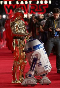 LOS ANGELES, CA - DECEMBER 09: C-3PO (L) and R2-D2 at Star Wars: The Last Jedi Premiere at The Shrine Auditorium on December 9, 2017 in Los Angeles, California. (Photo by Jesse Grant/Getty Images for Disney) *** Local Caption *** R2-D2; C-3PO