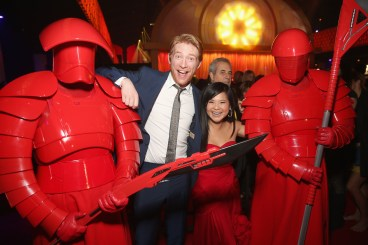 LOS ANGELES, CA - DECEMBER 09: Actor Domhnall Gleeson (2nd from L) and Kelly Marie Tran (2nd from R) pose with the Praetorian Guard at Star Wars: The Last Jedi Premiere at The Shrine Auditorium on December 9, 2017 in Los Angeles, California. (Photo by Jesse Grant/Getty Images for Disney) *** Local Caption *** Domhnall Gleeson; Kelly Marie Tran