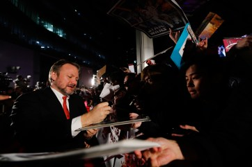 TOKYO, JAPAN - DECEMBER 06: Director Rian Johnson signs autograph for fans during the 'Star Wars: The Last Jedi' Japan Premiere & Red Carpet at Roppongi Hills on December 6, 2017 in Tokyo, Japan. (Photo by Christopher Jue/Getty Images for Disney) *** Local Caption *** Rian Johnson