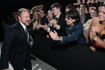 Director Rian Johnson greets fans on the red carpet for the world premiere of LucasfilmÕs Star Wars: The Last Jedi at the Shrine Auditorium in Los Angeles, December 9, 2017. (Photo: Alex J. Berliner / ABImages ).