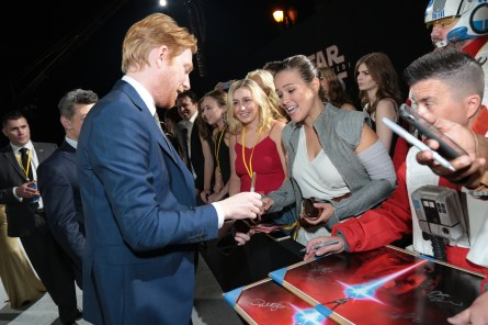 Domhnall Gleeson signs autographs with fans on the red carpet for the world premiere of LucasfilmÕs Star Wars: The Last Jedi at the Shrine Auditorium in Los Angeles, December 9, 2017..(Photo: Alex J. Berliner / ABImages )