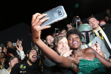 Mark Hamill and Lupita Nyong'o take a selfie with fans on the red carpet for the world premiere of LucasfilmÕs Star Wars: The Last Jedi at the Shrine Auditorium in Los Angeles, December 9, 2017..(Photo: Alex J. Berliner / ABImages )