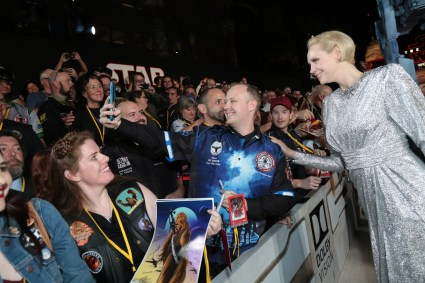 Gwendoline Christie poses with fans on the red carpet for the world premiere of LucasfilmÕs Star Wars: The Last Jedi at the Shrine Auditorium in Los Angeles, December 9, 2017..(Photo: Alex J. Berliner / ABImages )