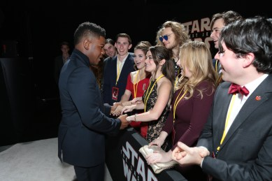 John Boyega signs autographs with fans on the red carpet for the world premiere of LucasfilmÕs Star Wars: The Last Jedi at the Shrine Auditorium in Los Angeles, December 9, 2017..(Photo: Alex J. Berliner / ABImages )