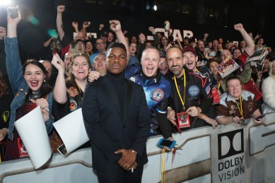 John Boyega poses with fans on the red carpet for the world premiere of LucasfilmÕs Star Wars: The Last Jedi at the Shrine Auditorium in Los Angeles, December 9, 2017..(Photo: Alex J. Berliner / ABImages )