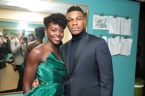 Lupita Nyong'o and John Boyega pose together backstage for the world premiere of LucasfilmÕs Star Wars: The Last Jedi at the Shrine Auditorium in Los Angeles, December 9, 2017..(Photo: Alex J. Berliner / ABImages )