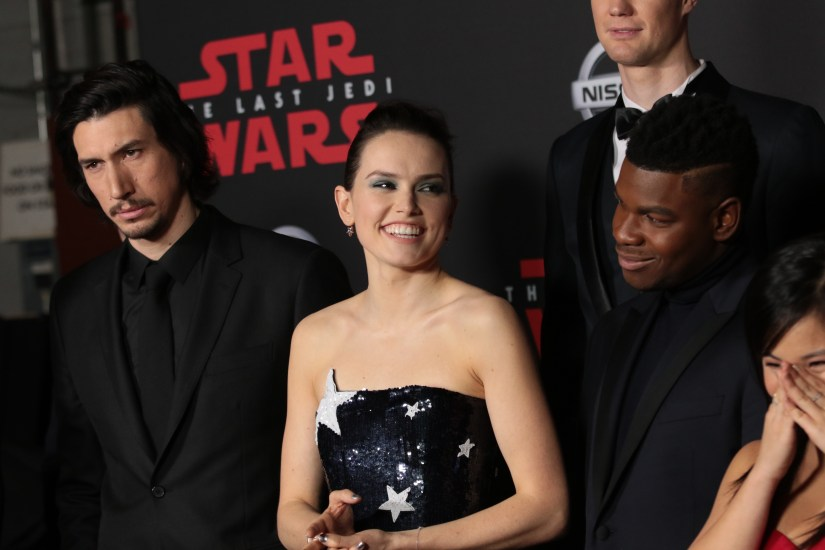 Adam Driver, Daisy Ridley and John Boyega pose together backstage for the world premiere of LucasfilmÕs Star Wars: The Last Jedi at the Shrine Auditorium in Los Angeles, December 9, 2017..(Photo: Alex J. Berliner / ABImages ).