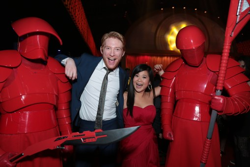 Domhnall Gleeson and Kelly Marie Tran pose with Praetorian guards at the after party for the world premiere of LucasfilmÕs Star Wars: The Last Jedi at the Shrine Auditorium in Los Angeles, December 9, 2017..(Photo: Alex J. Berliner / ABImages )