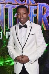 HOLLYWOOD, CA - JANUARY 29: Actor Denzel Whitaker at the Los Angeles World Premiere of Marvel Studios' BLACK PANTHER at Dolby Theatre on January 29, 2018 in Hollywood, California. (Photo by Alberto E. Rodriguez/Getty Images for Disney) *** Local Caption *** Denzel Whitaker
