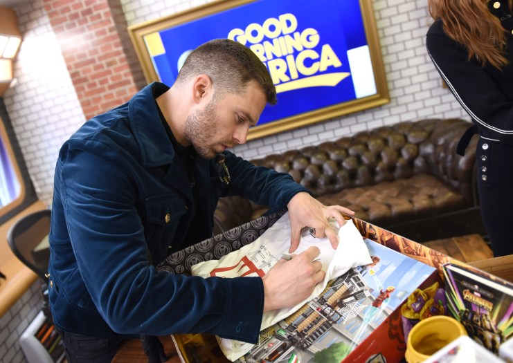 Marvel Studios' Avengers Infinity War talent Sebastian Stan autographs new movie products in Hero Acts box