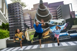 """Magic Kingdom Park guests enjoy fun backdrops from the upcoming Disney●Pixar film """"Incredibles 2"""" during the Incredible Tomorrowland Expo. During the super event, Mr. Incredible, Frozone, Mrs. Incredible and other characters from the """"The Incredibles"""" and the upcoming """"Incredibles 2,"""" join together for an interactive celebration featuring incredible decor and high-energy music. Families can even get their groove on during """"Super Party Time,"""" a continuous dance party and show on the Rockettower Plaza Stage. It's all part of Incredible Summer at Walt Disney World Resort. (Matt Stroshane, photographer)"""