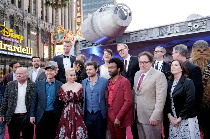 "HOLLYWOOD, CA - MAY 10: Cast and crew of ""Solo: A Star Wars Story"" attend the world premiere of ìSolo: A Star Wars Storyî in Hollywood on May 10, 2018. (Photo by Alberto E. Rodriguez/Getty Images for Disney) *** Local Caption *** Clint Howard; Jonathan Kasdan; John Powell; John Williams; Joonas Suotamo; Ron Howard; Woody Harrelson; Emilia Clarke; Thandie Newton; Phoebe Waller-Bridge; Alden Ehrenreich; Donald Glover; Paul Bettany; Jon Favreau; Kathleen Kennedy; Simon Emanuel; Jason McGatlin"