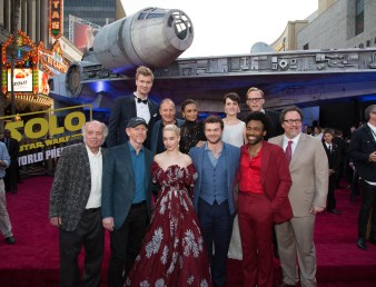 "(Back Row) Joonas Suotamo, Woody Harrelson, Thandie Newton, Phoebe Waller-Bridge, Paul Bettany, (Front Row) Clint Howard, Ron Howard, Emilia Clarke, Alden Enrenreich, Donald Glover, Jon Favreau attend the world premiere of ""Solo: A Star Wars Story"" in Hollywood on May 10, 2018..(Photo: Alex J. Berliner/ABImages)."