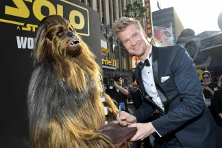 HOLLYWOOD, CA - MAY 10: Actor Joonas Suotamo (R) and Chewbacca attend the world premiere of ìSolo: A Star Wars Storyî in Hollywood on May 10, 2018. (Photo by Charley Gallay/Getty Images for Disney) *** Local Caption *** Joonas Suotamo; Chewbacca