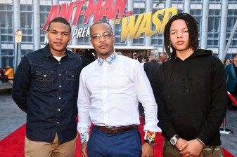 """HOLLYWOOD, CA - JUNE 25: (L-R) Messiah Harris, Actor Tip """"T.I."""" Harris and Domani Harris attend the Los Angeles Global Premiere for Marvel Studios' """"Ant-Man And The Wasp"""" at the El Capitan Theatre on June 25, 2018 in Hollywood, California. (Photo by Alberto E. Rodriguez/Getty Images for Disney) *** Local Caption *** Messiah Harris; Tip """"T.I."""" Harris; Domani Harris"""