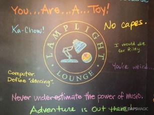 Pixar Quotes found near restrooms in Lamplight Lounge at Pixar Pier