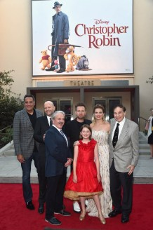 BURBANK, CA - JULY 30: (L-R) Actor Brad Garrett, Director Marc Forster, actors Jim Cummings, Ewan McGregor, Bronte Carmichael, Hayley Atwell and Songwriter Richard M. Sherman attend the world premiere of Disney's 'Christopher Robin' at the Main Theater on the Walt Disney Studios lot in Burbank, CA on July 30, 2018. (Photo by Alberto E. Rodriguez/Getty Images for Disney) *** Local Caption *** Brad Garrett; Jim Cummings; Marc Forster; Ewan McGregor; Bronte Carmichael; Hayley Atwell; Richard M. Sherman