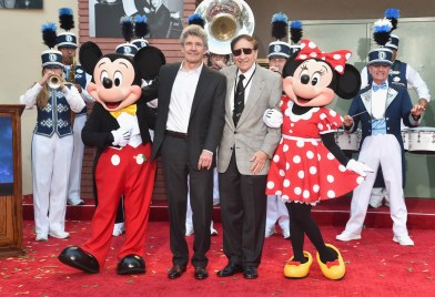 BURBANK, CA - JULY 30: (L-R) Mickey Mouse, Chairman, The Walt Disney Studios, Alan Horn, Songwriter Richard M. Sherman, Minnie Mouse and the Disneyland Band attend the dedication and re-naming of the historic Orchestra Stage, now the Sherman Brothers Stage A, on the Disney Burbank lot prior to the world premiere of Disney's 'Christopher Robin' at the studio's Main Theater, on July 30, 2018. (Photo by Alberto E. Rodriguez/Getty Images for Disney) *** Local Caption *** Mickey Mouse; Minnie Mouse; Alan Horn; Richard M. Sherman; Disneyland Band