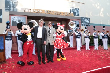 """Mickey Mouse, Alan Horn, Richard M. Sherman and Minnie Mouse pose together at the dedication and re-naming of the historic Orchestra Stage, now the Sherman Brothers Stage A, on the Disney Burbank lot prior to the world premiere of Disney's """"Christopher Robin"""" at the studio's Main Theater, on July 30, 2018 in Burbank, CA (Photo: Alex J. Berliner/ABImages)"""