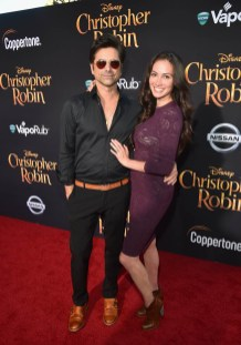 BURBANK, CA - JULY 30: John Stamos (L) and Caitlin McHugh attend the world premiere of Disney's 'Christopher Robin' at the Main Theater on the Walt Disney Studios lot in Burbank, CA on July 30, 2018. (Photo by Alberto E. Rodriguez/Getty Images for Disney) *** Local Caption *** John Stamos; Caitlin McHugh