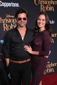 "John Stamos and Caitlin McHugh attend the world premiere of Disney's ""Christopher Robin"" at the Main Theater on the Walt Disney Studios lot in Burbank, CA on July 30, 2018. (Photo: Alex J. Berliner/ABImages)"