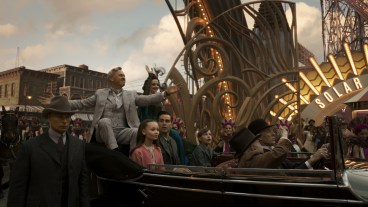 """THAT'S SHOW BUSINESS – In Disney's all-new, live-action feature film """"Dumbo,"""" persuasive entrepreneur V.A. Vandevere (Michael Keaton) recruits a flying elephant named Dumbo for his newest, larger-than-life entertainment venture, Dreamland. Dumbo soars to new heights alongside a stunning aerial artist, Colette Marchant (Eva Green). But Holt Farrier (Colin Farrell), who was originally enlisted to care for Dumbo with his kids (Nico Parker and Finley Hobbins), soon discovers that beneath its shiny veneer, Dreamland is full of dark secrets. Directed by Tim Burton, """"Dumbo"""" flies into theaters on March 29, 2019. ©2018 Disney Enterprises, Inc. All Rights Reserved."""