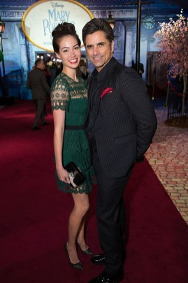 Caitlin McHugh and John Stamos attend The World Premiere of Disney's Mary Poppins Returns at the Dolby Theatre in Hollywood, CA on Wednesday, November 29, 2018 (Photo: Alex J. Berliner/ABImages)