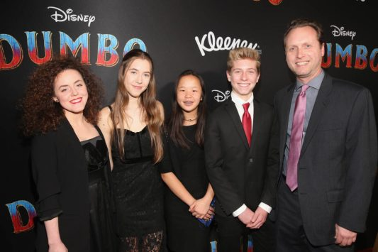 """LOS ANGELES, CA - MARCH 11: Screenwriter / Producer Ehren Kruger (R) and family attend the World Premiere of Disney's """"Dumbo"""" at the El Capitan Theatre on March 11, 2019 in Los Angeles, California. (Photo by Jesse Grant/Getty Images for Disney) *** Local Caption *** Ehren Kruger"""