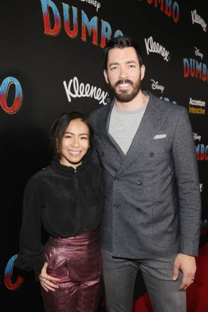 "LOS ANGELES, CA - MARCH 11: Drew Scott. (R) and Linda Phan attend the World Premiere of Disney's ""Dumbo"" at the El Capitan Theatre on March 11, 2019 in Los Angeles, California. (Photo by Jesse Grant/Getty Images for Disney) *** Local Caption *** Linda Phan; Drew Scott"