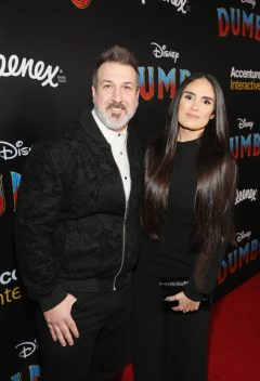 "LOS ANGELES, CA - MARCH 11: Joey Fatone (L) and Kelly Baldwin attend the World Premiere of Disney's ""Dumbo"" at the El Capitan Theatre on March 11, 2019 in Los Angeles, California. (Photo by Jesse Grant/Getty Images for Disney) *** Local Caption *** Kelly Baldwin; Joey Fatone"