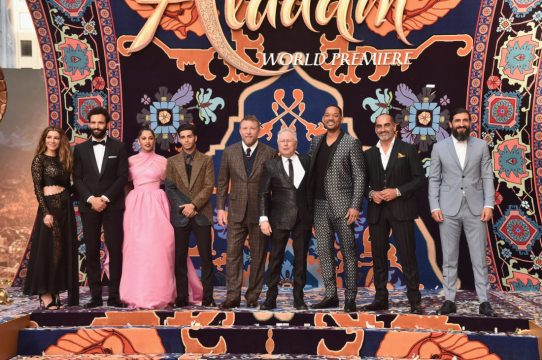 """LOS ANGELES, CA - MAY 21: (L-R) Actors Nasim Pedrad, Marwan Kenzari, Naomi Scott, Mena Massoud, director Guy Ritchie, Composer Alan Menken, actors Will Smith, Navid Negahban and Numan Acar attend the World Premiere of Disney's """"Aladdin"""" at the El Capitan Theater in Hollywood CA on May 21, 2019, in the culmination of the film's Magic Carpet World Tour with stops in Paris, London, Berlin, Tokyo, Mexico City and Amman, Jordan. (Photo by Alberto E. Rodriguez/Getty Images for Disney) *** Local Caption *** Nasim Pedrad; Marwan Kenzari; Naomi Scott; Mena Massoud; Will Smith; Navid Negahban; Numan Acar; Guy Ritchie; Alan Menken"""