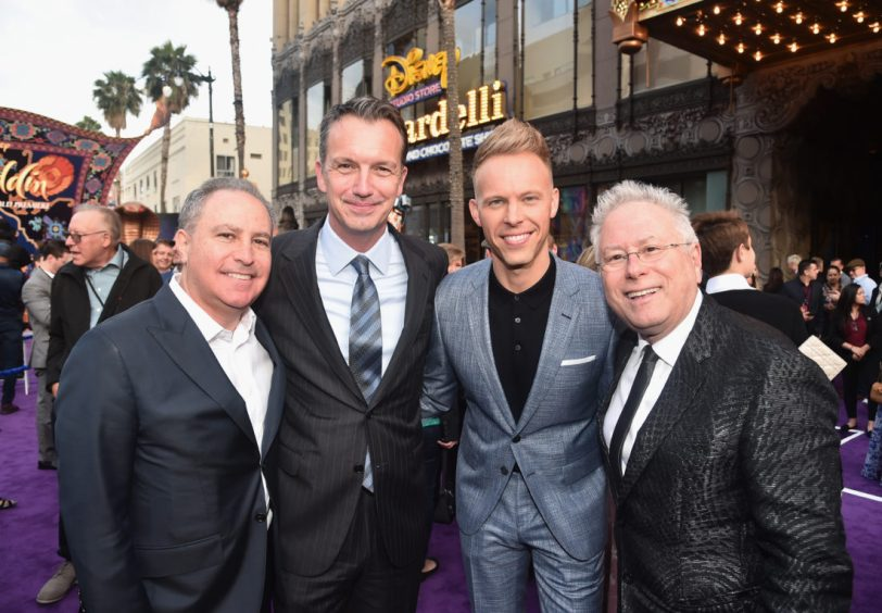 """LOS ANGELES, CA - MAY 21: (L-R) Walt Disney Studios President, Alan Bergman, President of Walt Disney Studios Motion Picture Production, Sean Bailey, Co-lyricist Justin Paul and Composer Alan Menken attend the World Premiere of Disney's """"Aladdin"""" at the El Capitan Theater in Hollywood CA on May 21, 2019, in the culmination of the film's Magic Carpet World Tour with stops in Paris, London, Berlin, Tokyo, Mexico City and Amman, Jordan. (Photo by Alberto E. Rodriguez/Getty Images for Disney) *** Local Caption *** Alan Bergman; Sean Bailey; Justin Paul; Alan Menken"""