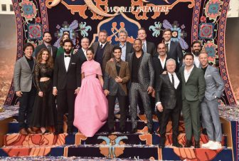"""LOS ANGELES, CA - MAY 21: (L-R front) Producer Dan Lin, actors Nasim Pedrad, Marwan Kenzari, Naomi Scott, Mena Massoud, Will Smith, Navid Negahban, Composer Alan Menken and co-lyricists Benj Pasek and Justin Paul. (L-R back) SVP, Production, The Walt Disney Studios, Louie Provost, Walt Disney Studios President, Alan Bergman, Director Guy Ritchie, Chairman, The Walt Disney Studios, Alan Horn, President of Walt Disney Studios Motion Picture Production, Sean Bailey, Producer Jonathan Eirich and actor Numan Acar attend the World Premiere of Disney's """"Aladdin"""" at the El Capitan Theater in Hollywood CA on May 21, 2019, in the culmination of the film's Magic Carpet World Tour with stops in Paris, London, Berlin, Tokyo, Mexico City and Amman, Jordan. (Photo by Alberto E. Rodriguez/Getty Images for Disney) *** Local Caption *** Dan Lin; Nasim Pedrad; Marwan Kenzari; Naomi Scott; Mena Massoud; Will Smith; Navid Negahban; Alan Menken; Benj Pasek; Justin Paul; Louie Provost; Alan Bergman; Guy Ritchie; Alan Horn; Sean Bailey; Jonathan Eirich; Numan Acar"""
