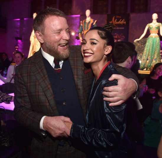 """LOS ANGELES, CA - MAY 21: Director Guy Ritchie (L) and Naomi Scott attend the World Premiere of Disney's """"Aladdin"""" at the El Capitan Theater in Hollywood CA on May 21, 2019, in the culmination of the film's Magic Carpet World Tour with stops in Paris, London, Berlin, Tokyo, Mexico City and Amman, Jordan. (Photo by Alberto E. Rodriguez/Getty Images for Disney) *** Local Caption *** Guy Ritchie; Naomi Scott"""